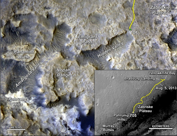 The main map displays the assortment of landforms near the location of NASA's Curiosity Mars rover, which has been on the red planet for almost 2 years. The gold traverse line starting at the upper right ends at Curiosity's position as of the 705th Martian day of the mission, July 31, 2014. The inset map tracks the mission's entire route from the landing on Aug. 5, 2012, PDT (Aug. 6, UTC) to Sol 705.