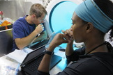 European Space Agency astronaut Thomas Pesquet (left) and NASA astronaut Jeanette Epps perform experiments during the NEEMO 18 mission in July 2014.