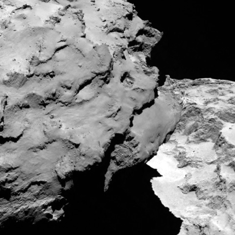 "Rosetta spacecraft's OSIRIS narrow-angle camera obtained this close-up detail of comet 67P/Churyumov-Gerasimenko on August 6, 2014. The comet's ""head"" lies at the left, casting shadows onto the ""neck"" and ""body"" to the right."