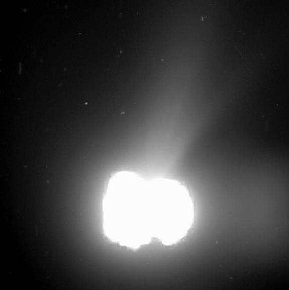 Rosetta spacecraft obtained this 330 second exposure of comet 67P/Churyumov-Gerasimenko. from a distance of 342 miles (550 km). The comet nucleus was saturated to bring out detail. Note a ghost image floats at the right.