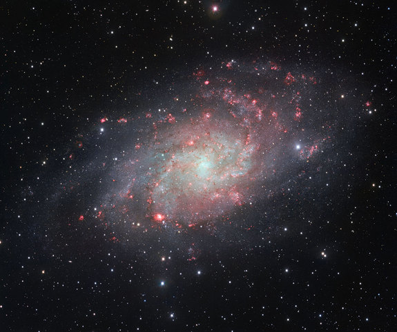 M33, the Triangulum Galaxy, taken by the VLT Survey Telescope at the European Southern Observatory's Paranal Observatory in Chile. The picture reveals gassy regions, shown in red.