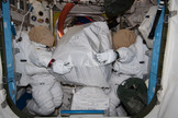 Two unoccupied NASA spacesuits appear to carry a storage bag on the International Space Station in this photo by an Expedition 40 crewmember released on Aug. 8, 2014.