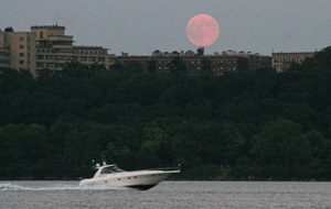 Our own Executive Producer of the Visual Content Team, Dave Brody, caught the supermoon as a powerboat went speeding by over the Hudson river. The supermoon hangs over western Manhattan on August 10, 2014.