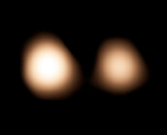 ALMA radio observatory in Chile observed Pluto and its largest moon, Charon, on July 15, 2014.