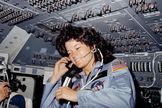 Astronaut Sally K. Ride, STS-7 mission specialist and first American woman in space, is seen here on the flight deck of the space shuttle Challenger, June 18, 1983.