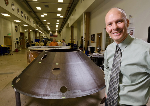 Stu Spath, InSight program manager at Lockheed Martin Space Systems Company, near the back shell for the Mars-bound Interior exploration using Seismic Investigations, Geodesy and Heat Transport (InSight) spacecraft.