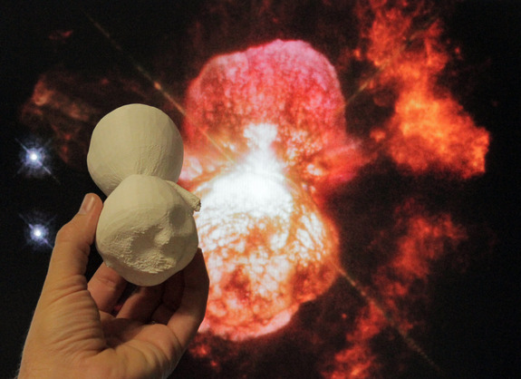 A 3D-printed model of the Homunculus Nebula is compared to a Hubble Space Telescope image of the same object in this NASA photo.