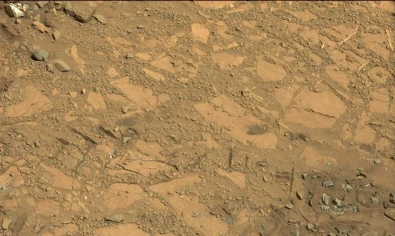 "This photo taken on Aug. 12, 2014 by NASA's Curiosity Mars rover shows an outcrop that includes the ""Bonanza King"" rock under consideration as a drilling target."