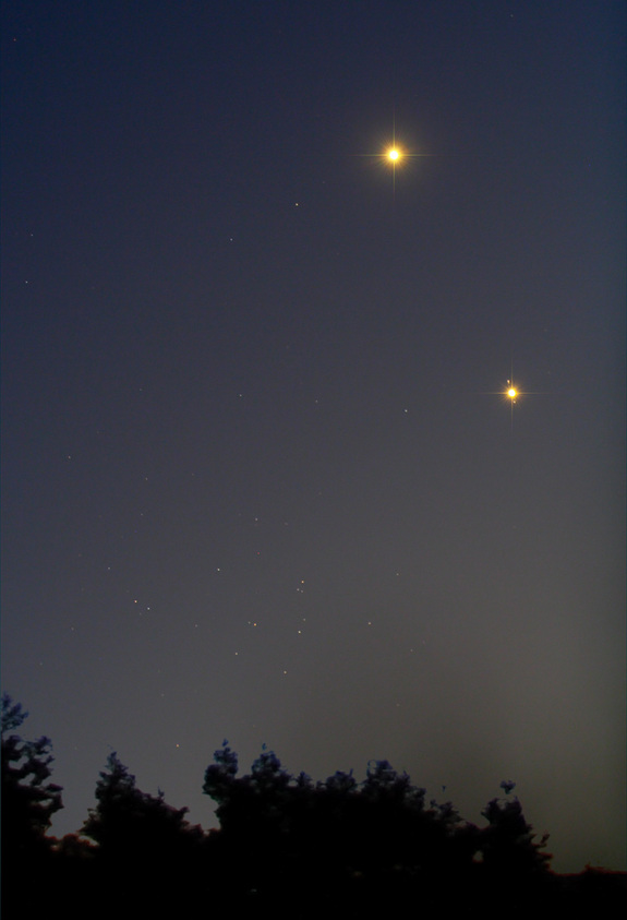 Chris Schur captured this image of Jupiter, Venus and the M44 star cluster in the night sky on Aug. 18, 2014.