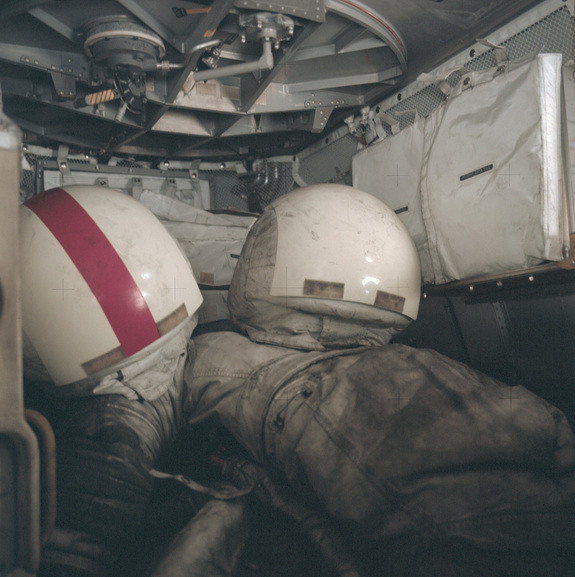At the conclusion of Apollo 17's mission in December 1972, moonwalking suits and space helmets are covered by lunar dust.