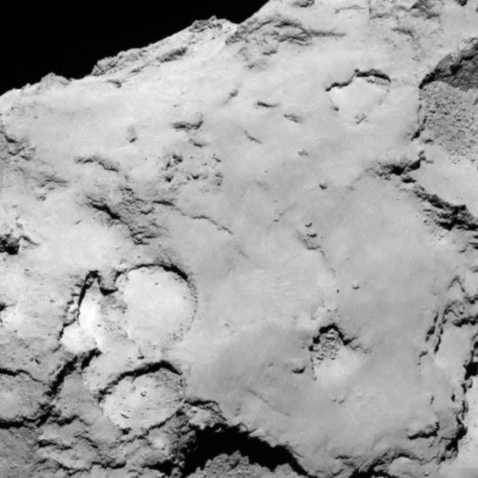 Philae lander candidate site C is located on the larger lobe of the comet. It offers a variety of surface features including some brighter material, depressions, cliffs, hills and smooth plains. Image released Aug. 25, 2014.