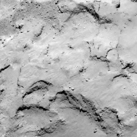 Philae lander candidate site J lies on the smaller lobe of the comet. Similar to site I, this site also presents interesting surface features with good illumination. It offers advantages for the CONSERT experiment compared with I. Image released August 25. 2014.