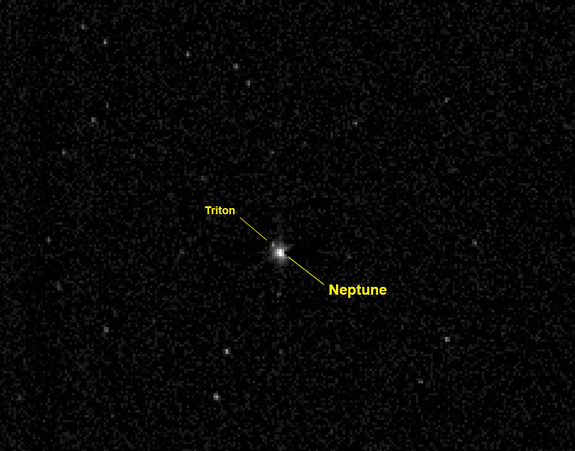 This labeled photo identifies the planet Neptune and its large moon Triton as they appeared to NASA's New Horizons spacecraft on July 10, 2014 from a distance of 2.45 billion miles (3.96 billion km). New Horizons is headed for a 2015 flyby of the dwarf planet Pluto. On Aug. 25, 2014, the probe passed the orbit of Neptune.
