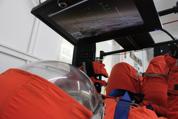 Final Frontier Design's third-generation spacesuit in a flight simulator.