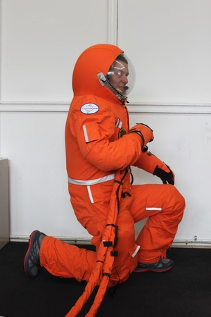 Final Frontier Design's Ted Southern kneels in the third version of his spacesuit.