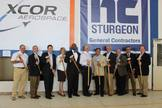 XCOR Aerospace representatives and Midland, Texas officials pose for a photo during a ceremonial wall-breaking event to mark the start of renovations on a hangar at Midland International Airport in Texas, the future home of XCOR's private Lynx space plane, on Aug. 15, 2015.