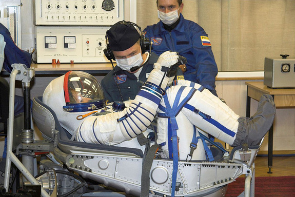 A Sokol space suit-up.