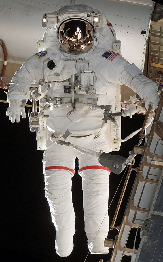 An astronauts in an extravehicular activity (EVA) EMU suit during space shuttle mission STS-118.