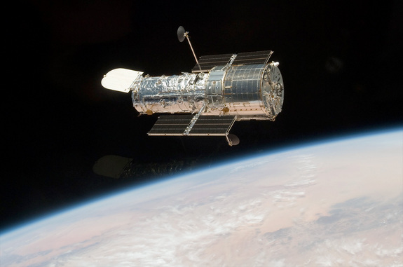 The Hubble Space Telescope is seen in orbit above the Earth as photographed from the space shuttle in May 2009.