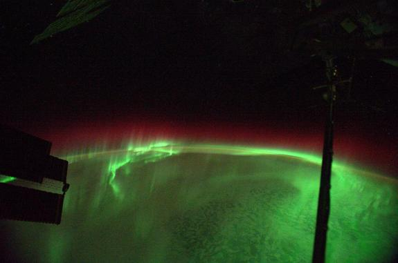 Red and green auroras glow below the International Space Station in this photo from Alexander Gerst posted to Twitter on Aug. 29, 2014.