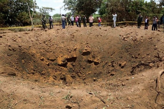 Officials say that a meteorite probably created this 40-foot-wide crater in Nicaragua overnight on Sept. 6, 2014.