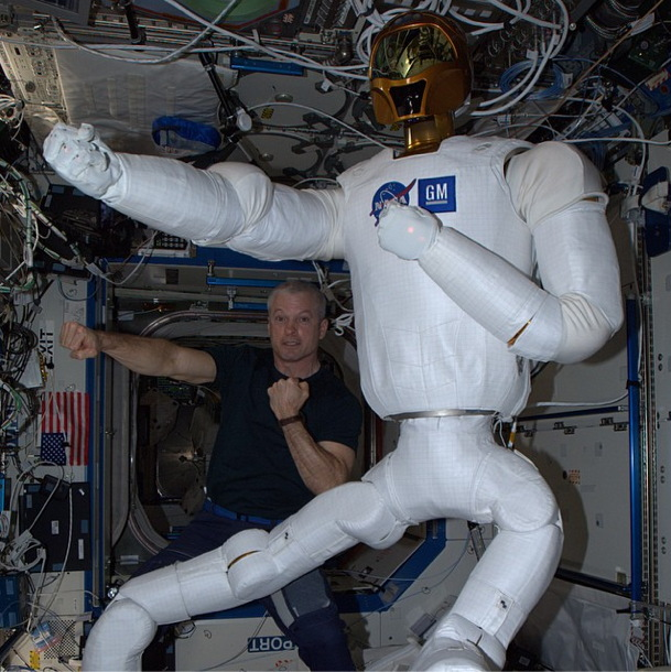 Robonaut 2 and Astronaut Swanson on the International Space Station
