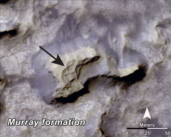 "This mesa within the ""Murray Buttes"" area on Mars evinces a complex fracture pattern (black arrow) protruding from the eroding rock. Image taken with the High Resolution Imaging Science Experiment (HiRISE) camera. Image released Sept. 11, 2014."