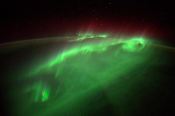 The northern lights dance over Earth in shimmering green light on Aug. 29, 2014 in this amazing photo by European Space Agency astronaut Alexander Gerst on the International Space Station. Recent solar storms on Sept. 8 and 10 may amplify Earth's northern lights displays this weekend, space weather scientists say.
