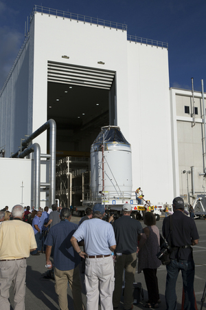 The Orion crew module, on top of a service module, is moved from an operations and checkout building at NASA's Kennedy Space Center on Sept. 11 to a nearby payload hazardous servicing facility. The spacecraft is being readied for a December test flight.