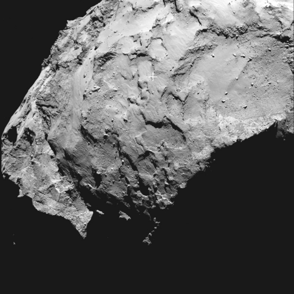 A cross marks the landing spot on Comet Comet 67P/Churyumov-Gerasimenko for the Philae lander in this image captured by the lander's mothership, the Rosetta spacecraft. The European Space Agency, which runs Rosetta, unveiled the landing target on Sept. 15, 2014, with touchdown set for Nov. 11.