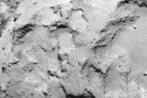 "This close-up of the Comet 67P/Churyumov–Gerasimenko shows a super closeup view of the landing site (marked) for the Philae lander on the European Space Agency's Rosetta spacecraft. The target, called Landing Site J, is near the ""head"" of the comet, with landing set for Nov. 11, 2014."