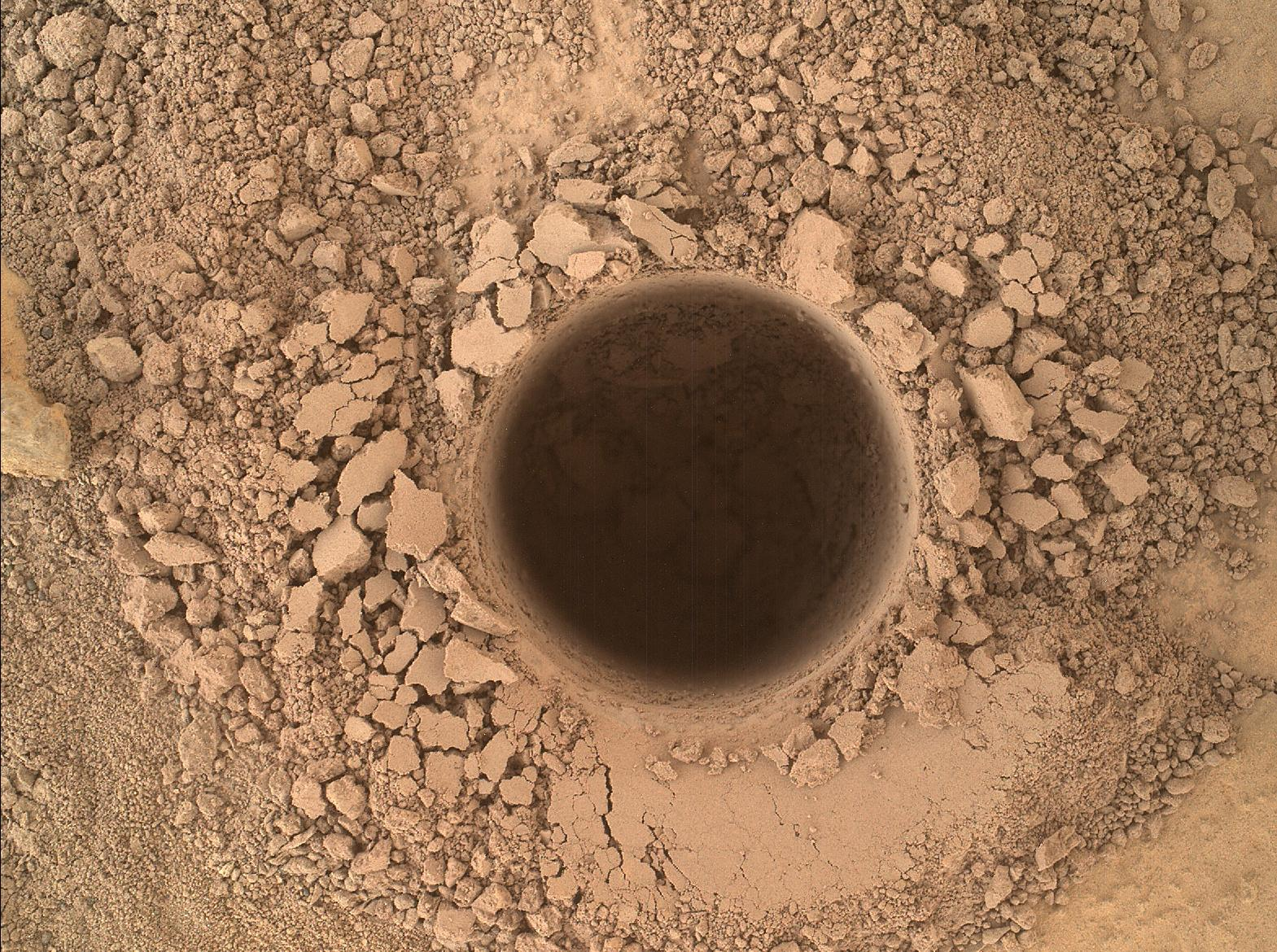 Mars Rover Curiosity Drills 1st Hole into Huge Martian Mountain