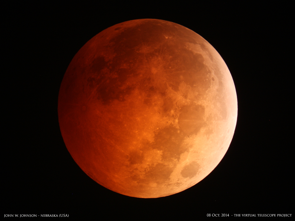 "The spectacular ""blood moon"" total lunar eclipse of Oct. 8, 2014 is captured by photographer John W. Johnson of the Omaha Astronomical Society in Nebraska in the United States."