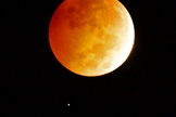 Astrophotographer Greg Diesel captured this photo of the total lunar eclipse and Uranus on Oct. 8, 2014.