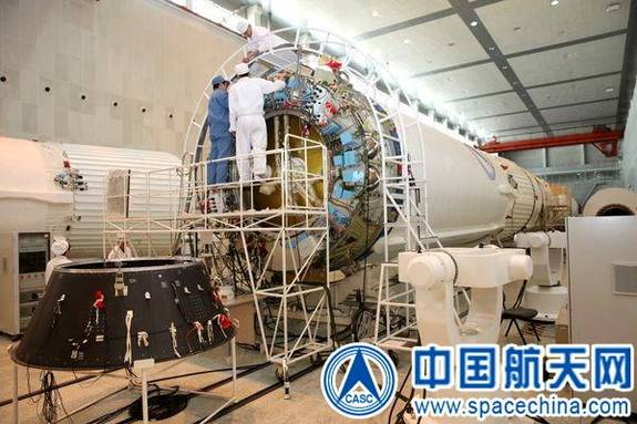 Long March booster being readied to support China's next mooncraft takeoff this month, dedicated to testing technology for future lunar sample-return mission.