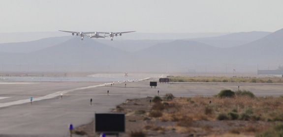 Virgin Galactic's private spaceliner SpaceShipTwo and its carrier plane WhiteKnightTwo take to the skies over the Mojave Air and Space Port in California during an Oct. 7, 2014, glide test of SpaceShipTwo.
