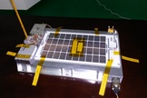 The 4M payload, which will hitchhike on the last stage of a Chinese rocket set to blast off on Oct. 23, 2014. 4M will complete a flyby around the moon and head back to Earth orbit, sending out signals to be received by amateur radio operators all the while.