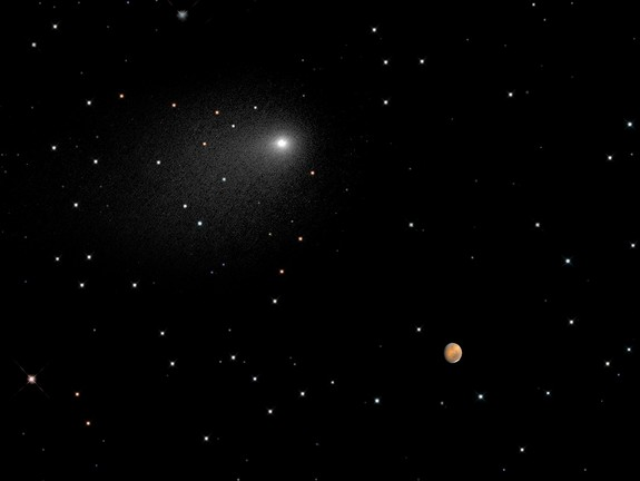 A NASA Hubble Space Telescope composite image shows the positions of comet Siding Spring and Mars as the comet streaked by the red planet, at 2:28 p.m. EDT on Oct. 19, 2014.