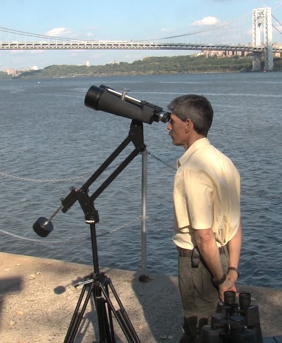 "A sturdy tripod and a conterweighted arm make for hours of easy wiggle-free observing, even with massive binoculars. Note that the author (pictured) is not touching the binoculars or tripod. <a href=""http://store.space.com/celestron-skymaster-25x100-binoculars.html?&ICID=SPACE-binoculars-buying-guide-2014-10-23"" target=""_blank"" rel=""nofollow"">BUY these Celestron SkyMaster 25x100 binoculars >>></a>"