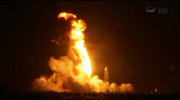 An Orbital Sciences Antares rocket explodes in flames during a failed launch on Oct. 28, 2014 from NASA's Wallops Flight Facility on Wallops Island, Virginia. The rocket was carrying an unmanned Cygnus spacecraft filled with 5,000 lbs. of supplies for the International Space Station.