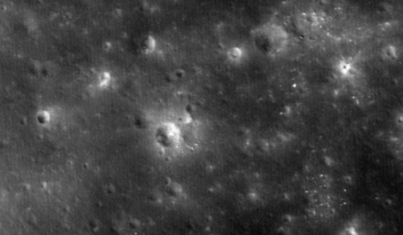 The crater gouged out when NASA's LADEE probe crashed intentionally into the moon on April 18, 2014 is visible as a small white smudge to the upper right of the large central crater in this image captured by the space agency's Lunar Reconnaissance Orbiter.