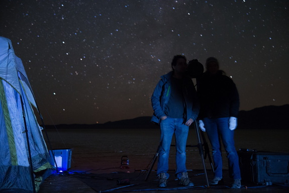 Steve Warwick, Northrop Grumman program manager for Starshade field testing, and Tiffany Glassman, astronomer and principal investigator for Starshade field testing, stand in the Starshade's shadow at the telescope station, demonstrating the technology's desired effect.