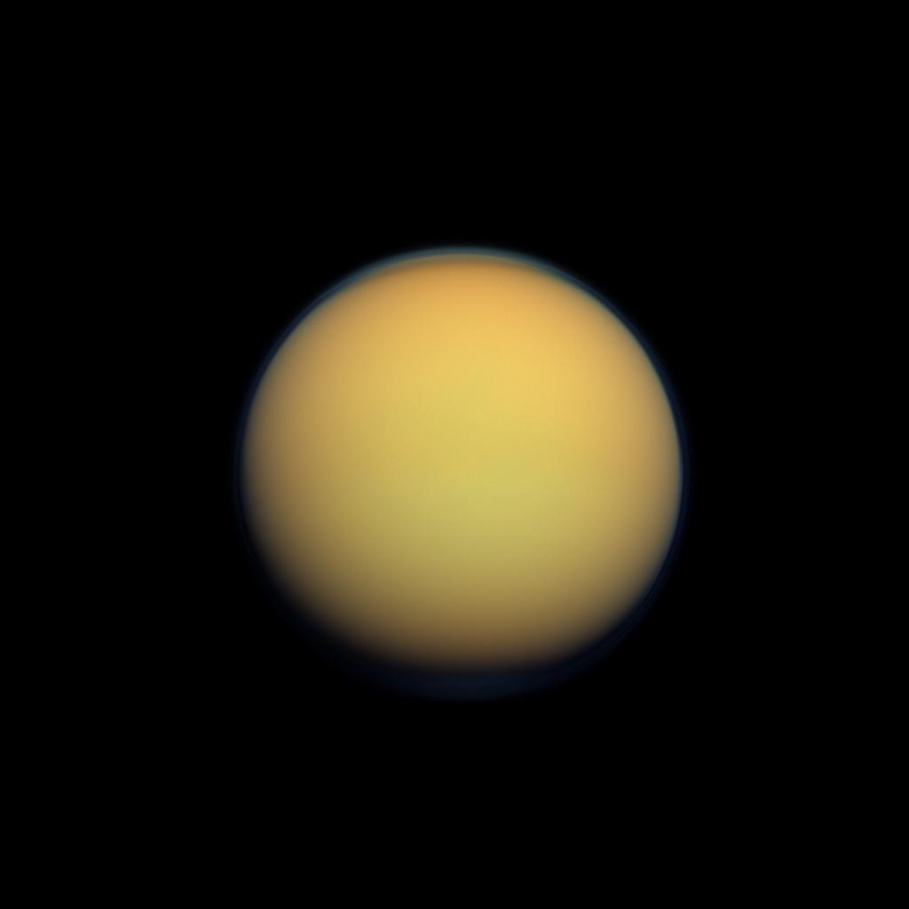 Saturn's moon Titan appears as a hazy ball from a distance in this photo taken by NASA's Cassini spacecraft.