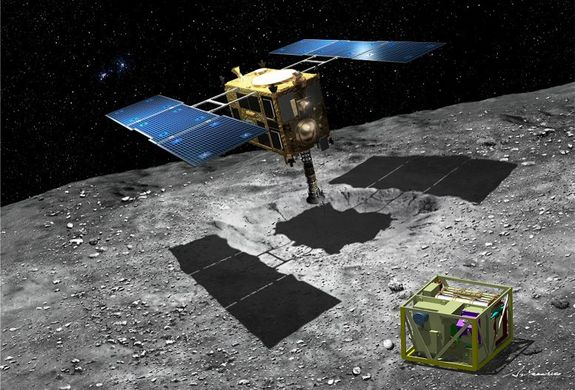 An artist's impression of Japan's Hayabusa2 asteroid sample-return spacecraft with the MASCOT lander at the asteroid 1999 JU3. The mission aims to rendezvous with the asteroid in 2018 and return samples to Earth by 2020.