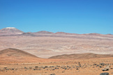 The European Extremely Large Telescope (E-ELT) will eventually stand on the summit of Cerro Armazones, which is being leveled (upper left). A new wider road to the mountain stretches across the photo. Image released Dec. 4, 2014.