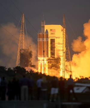 A Delta 4 Heavy rocket carrying NASA's Orion spacecraft lifts off from Cape Canaveral Air Force Station at at 7:05 a.m. EST, Dec. 5, 2014, in Florida. Launch was postponed one day because of technical glitches and weather.