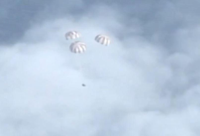 Orion Capsule with Three Main Chutes Deployed