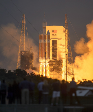 Spectators look on as a United Launch Alliance Delta IV Heavy rocket launches NASA's first Orion space capsule on an unmanned test flight from Cape Canaveral Air Force Station in Florida on Dec. 5, 2014.