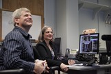 NASA's New Horizon Pluto flyby mission operations manager Alice Bowman and operations team Karl Whittenburg watch screens for signals confirming that the New Horizons probe awoke from hibernation on Dec. 6, 2014. The New Horizons mission is managed from the Johns Hopkins Applied Physics Laboratory in Laurel, Maryland.