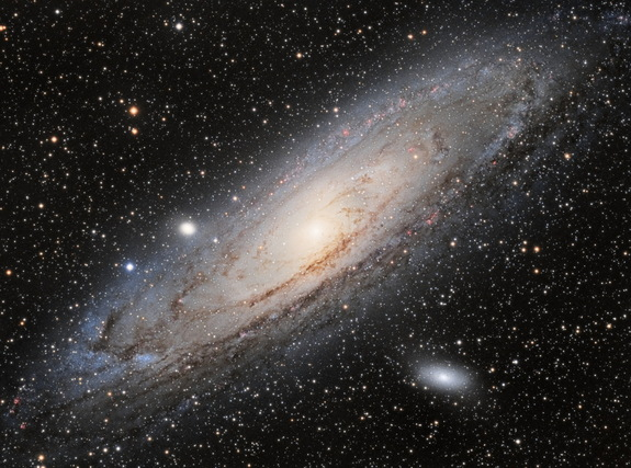 Astronomers have spotted a possible signal of dark matter in X-rays streaming from the Andromeda galaxy (pictured) and the Perseus galaxy cluster.